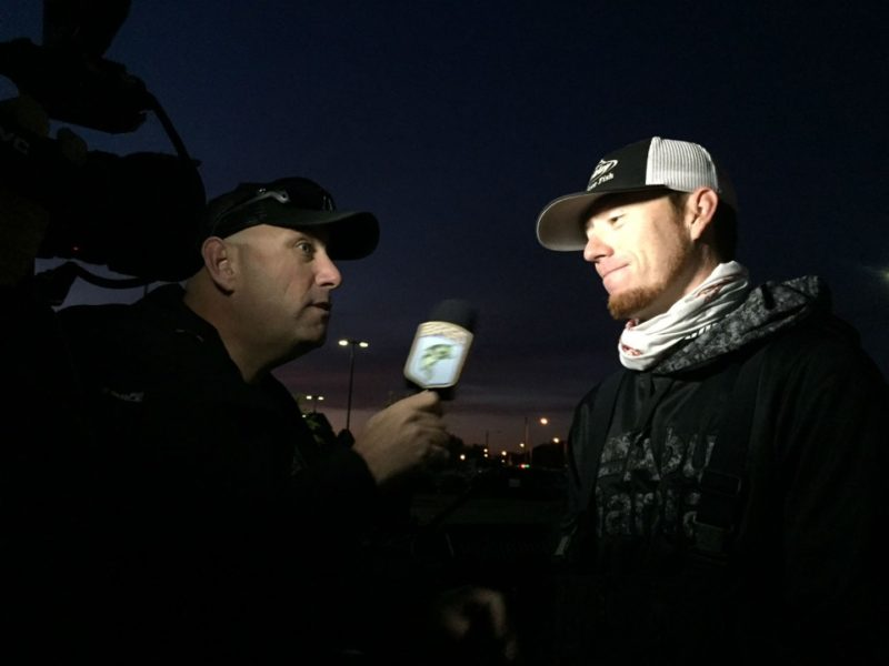 The life of a pro starts early for Josh Bertrand as he is interviewed in the predawn light. Photo by Bassmaster Marshal Joe McElroy