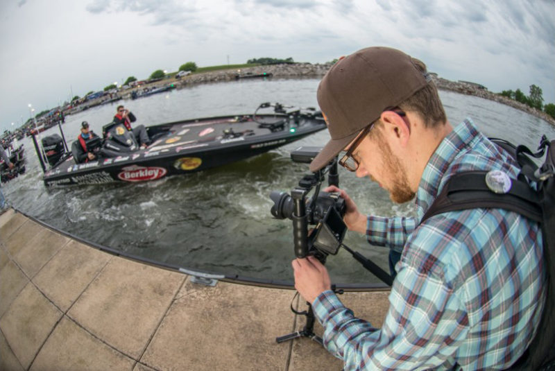 Josh Bertrand motors by the dock as Chris Shangle captures some slow motion footage. Photo: Garrick Dixon
